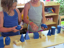 children playing with geometric blocks